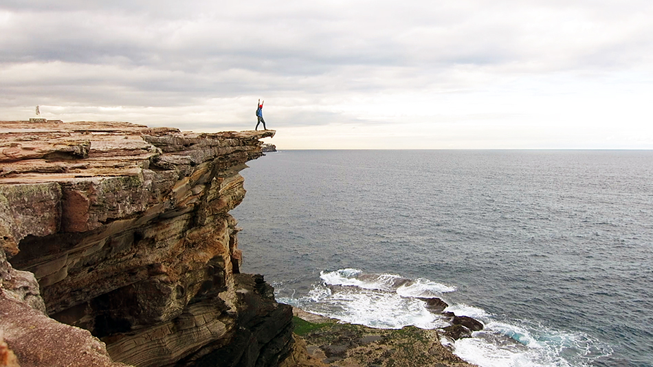 Kevin on a cliff in Sydney overlooking the ocean