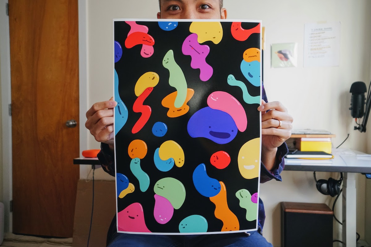 Kevin holding a printout of a Friends With Shape printed artwork