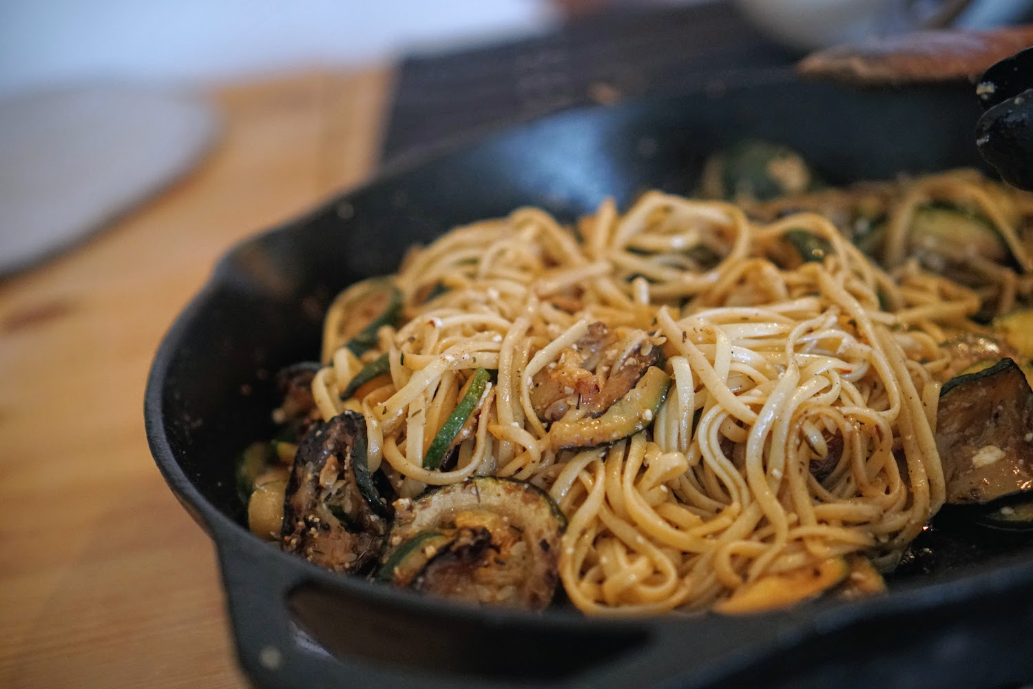 Linguine with zucchini in a cast iron pan